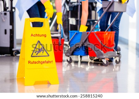 Warning sign on floor in cleaning operation - stock photo