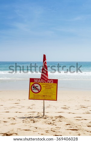 Warning sign on the beach swimming prohibited - stock photo