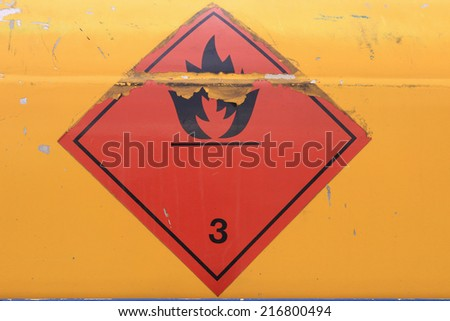 Warning sign on vehicle with tank for flammable liquid. Transportation of flammable and combustible liquids. - stock photo