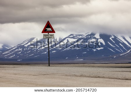 Warning sign polar bears, Spitsbergen, Svalbard, Norway - stock photo