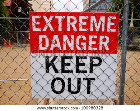 warning sign posted on the fence - stock photo
