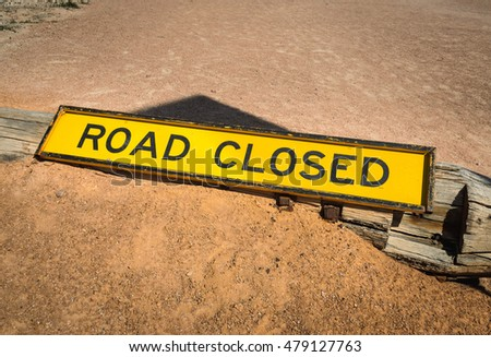 Warning sign road closed on ground