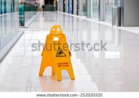 Warning sign slippery - stock photo