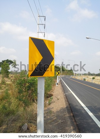 Warning  signs  beside  the  road ,  turn  right     - stock photo