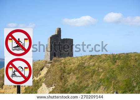 warning signs for surfers at ballybunion castle on the wild atlantic way in ireland - stock photo