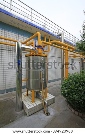 Warning signs in wastewater treatment plant water-sealed tank, closeup of photo - stock photo