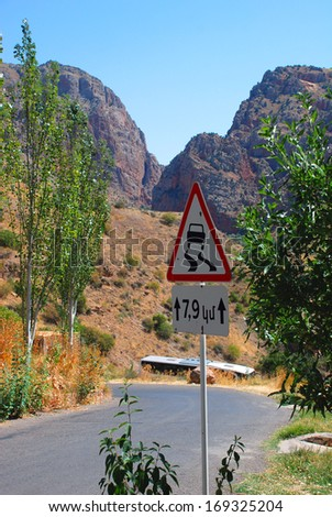 Warning slippery road sign, in a Countryside road - stock photo