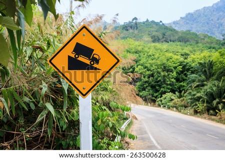 Warning steep road sign - stock photo