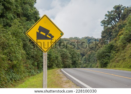 warning steep road sign slope and truck on hill - stock photo