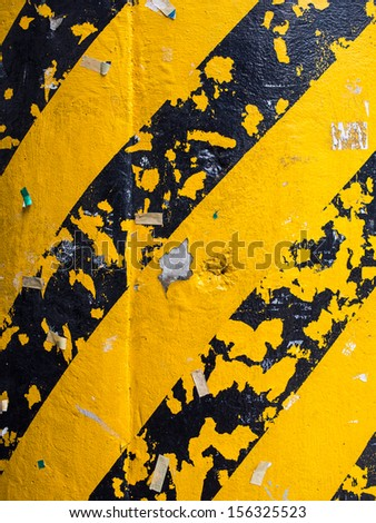 Warning stripes on concrete column