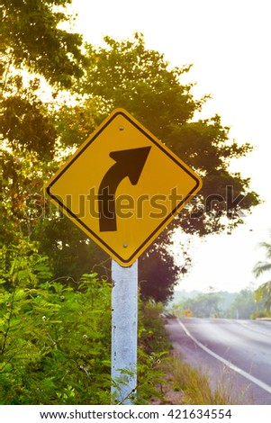 Warning traffic sign right curve  - stock photo