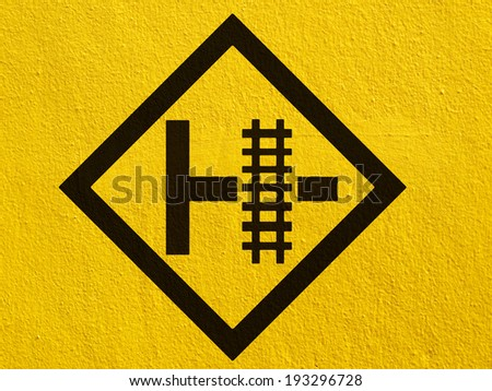 warning train sign painted on a stucco wall outside - stock photo