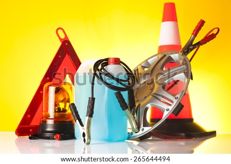 warning triangle and car service accessories - stock photo