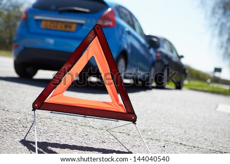 Warning Triangle By Two Cars Involved In Accident - stock photo