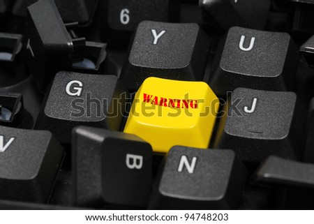 warning word on yellow and black keyboard button - stock photo
