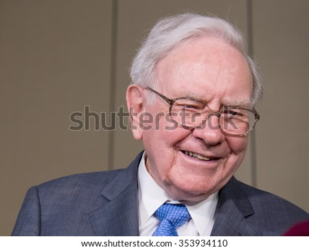 Warren Buffett, chairman and CEO of Berkshire Hathaway is interviewed after the annual Berkshire Hathaway shareholders meeting held at the CenturyLink Center in Omaha, Neb. on Saturday, May 2, 2015.   - stock photo