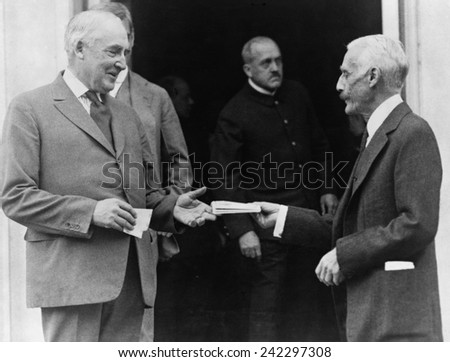 Warren G. Harding (1865-1923), buys treasury savings certificates from Secretary of the Treasury, Andrew Mellon. The long term bonds were offered to pay off the war debt. 1922 photo.