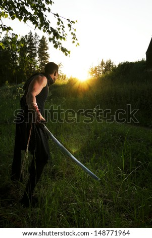 warrior and sunset - stock photo