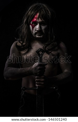 Warrior waiting, fight, medieval soldier with huge steel sword - stock photo