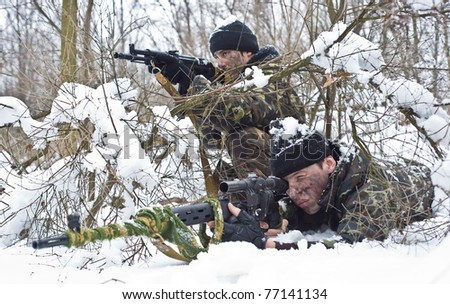 Warriors with a weapon.Ambush.sniper rifle to the position.  A group of soldiers of the special setting is in the winter forest.military action. - stock photo