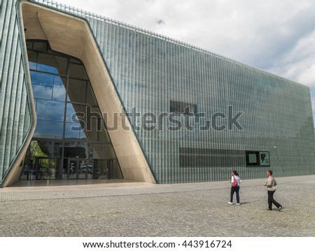 WARSAW - JUN 21 : Unidentified people  walking towards Polin Museum of the History of Polish Jews  on June 21, 2016 in Warsaw, Poland.