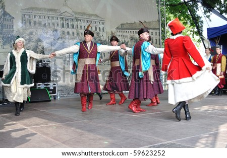 "WARSAW - MAY 30: Former national dance performed by Song and Dance Ensemble ""Male Podlasie"" - on the occasion of the 200th anniversary of the birth of Fryderyk Chopin. MAY 30, 2010 in Warsaw, Poland. - stock photo"