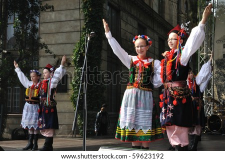 "WARSAW - MAY 30: Krakowiak dancs performed by Song and Dance Ensemble ""Male Podlasie"" - on the occasion of the 200th anniversary of the birth of Fryderyk Chopin. MAY 30, 2010 in Warsaw, Poland. - stock photo"