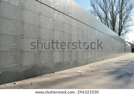 WARSAW - OCTOBER 07: Memorial Wall with the names of thousands of insurgents who died in the Uprising against the German occupiers (1944) - Warsaw Uprising Museum - on October 07, 2010 in Poland. - stock photo