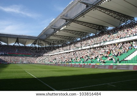 WARSAW, POLAND - APRIL 29: Beautiful Pepsi Arena stadium before the football match between Legia Warsaw vs Jagiellonia Bialystok on April 29, 2012 in Warsaw, Poland. Final results: 1:1 - stock photo