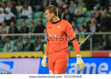 WARSAW, POLAND - APRIL 22, 2016: Grzegorz Sandomierski (Cracovia Cracov goalkeeper) in action during polish league football match between Legia Warszawa and Cracovia Cracov in Warsaw.