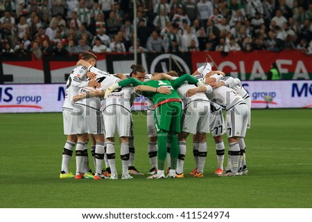 WARSAW, POLAND - APRIL 15, 2016: Legia Warsaw players just before polish league football match between Legia Warszawa and Lech Poznan in Warsaw.  - stock photo