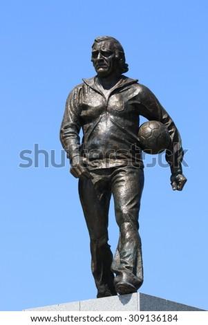 WARSAW, POLAND - AUGUST 15, 2015: A statue of legendary Polish football coach Kazimierz Gorski. Kazimierz Gorski was the coach for the Polish national team in 73 matches (with 45 wins). - stock photo