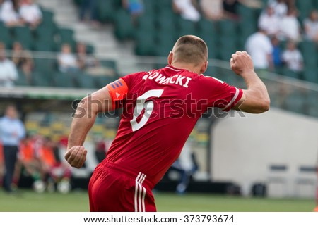 WARSAW, POLAND - AUGUST 09, 2015: Arkadiusz Glowacki (Wisla Krakow) during Polish League football match between Legia Warsaw and Wisla Cracow in Warsaw. - stock photo