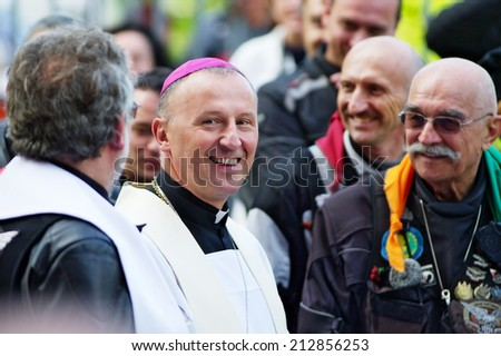 WARSAW, POLAND - AUGUST 23: Bishop Marek Solarczyk, auxiliary Bishop of Warsaw-Praga diocese, greets participants of the 14th Motorcycle Katyn Rally on August 23, 2014 in Warsaw, Poland.