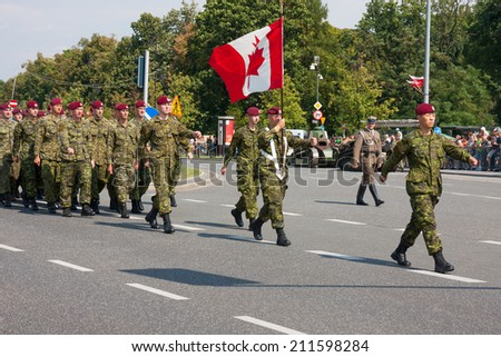 WARSAW, POLAND - AUGUST 15, 2014: Canadian Armed Forces during the parade. Polish Armed Forces Day. Over 1200 Polish and over 90 foreign soldiers, over 120 military vehicles, more than 50 aircraft - stock photo