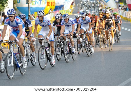 "WARSAW, POLAND - AUGUST 1, 2010: Cyclists along the route of the cycling race ""Tour de Pologne"" - from Sochaczew to Warsaw. - stock photo"