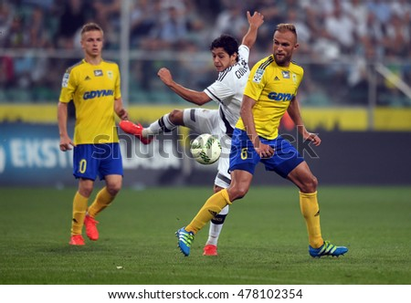WARSAW, POLAND -AUGUST 20, 2016: Extra League Polish Premier Football League Legia Warsaw Arka Gdynia o/p: Mateusz Szwoch of Arka Gdynia  Antoni Lukasiewicz of Arka Gdynia Guilherme of Legia Warszawa