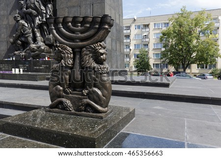 WARSAW, POLAND - AUGUST 05, 2016: Jewish Menorah candlestick that is one of the oldest symbols of the Jewish faith can be seen in front of Ghetto Heroes Monument.