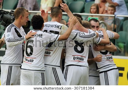 WARSAW, POLAND - AUGUST 09, 2015: Legia Warsaw players after scoring a goal during Polish League football match between Legia Warsaw and Wisla Cracow in Warsaw. - stock photo