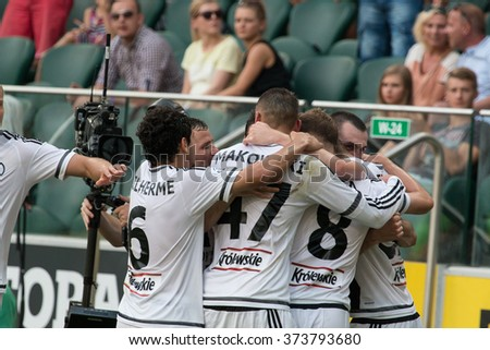 WARSAW, POLAND - AUGUST 09, 2015: Legia Warsaw players celebrate after scoring a goal during Polish League football match between Legia Warsaw and Wisla Cracow in Warsaw. - stock photo