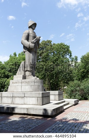 WARSAW, POLAND - AUGUST 05, 2016: Monument to Soldier of the First Polish Army that is made of granite shows the soldier standing at attention who holds in hands a machine gun