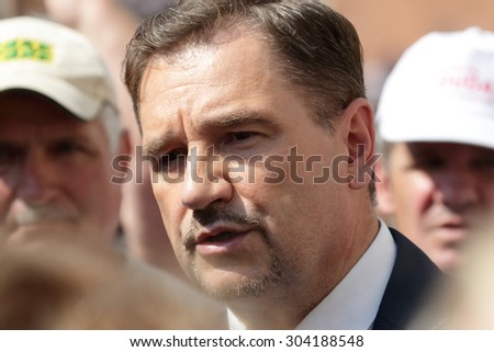WARSAW, POLAND - AUGUST 06, 2015: Piotr Duda, leader of Solidarity trade union during a meeting with people on the street of Warsaw.. - stock photo