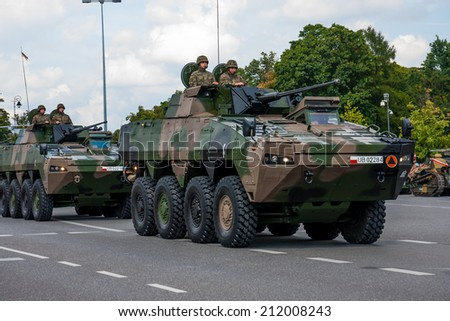 WARSAW, POLAND - AUGUST 15, 2014: Polish Wolverine. Rosomak KTO - Wheeled Armored Vehicle. Polish Armed Forces Day. 1200 Polish and over 90 foreign soldiers, over 120 military vehicles, 50 aircraft