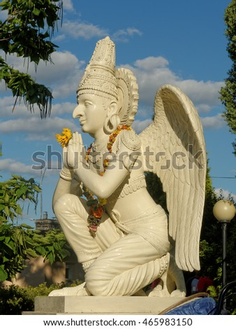 WARSAW, POLAND - AUGUST 07. Sunday program in Hare Krishna Temple in Mysiadlo - Warsaw, August 07, 2016. Statue of Garuda - carrier of Lord Vishnu set out in front of the Main Altar.