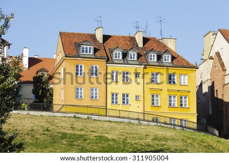WARSAW, POLAND - AUGUST 18, 2015: Townhouses at the Brzozowa Street in the Old Town, burned down during the World War II, rebuilt after the war with numerous changes in the appearance of the houses - stock photo
