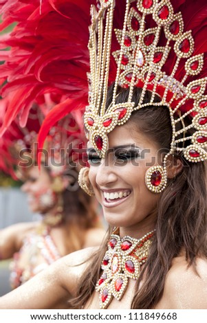 WARSAW, POLAND, AUGUST 26: Unidentified Carnival dancer on the parade on Warsaw Multicultural Street Parade on August 26, 2012 in Warsaw, Poland. - stock photo