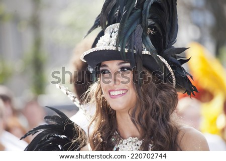 WARSAW, POLAND, August 31: Unidentified Carnival dancer on the parade on Warsaw Multicultural Street Party on August 31, 2014 in Warsaw, Poland. - stock photo