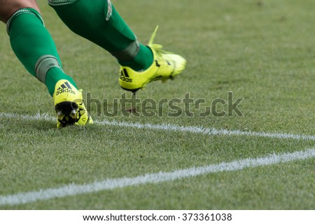 WARSAW, POLAND - AUGUST 09, 2015: Wisla Krakow goalkeeper feet in action during Polish League football match between Legia Warsaw and Wisla Cracow in Warsaw. - stock photo