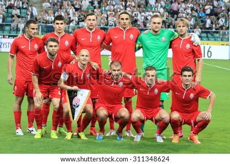 WARSAW, POLAND - AUGUST 27, 2015: Zoria Lugansk team before UEFA Europe League qualifications football match between Legia Warsaw (Poland) and Zoria Lugansk (Ukraine) in Warsaw. Legia beat Zoria 3:2 - stock photo