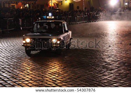 WARSAW, POLAND - DECEMBER 13: Staged riots in the Warsaw Old Town on the 28th anniversary of the introduction of Martial Law, on December 15, 2009 in Warsaw, Poland. - stock photo